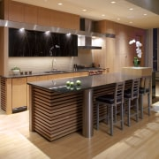 View of contemporary kitchen with wooden features and cabinetry, countertop, floor, flooring, hardwood, interior design, kitchen, laminate flooring, table, wood, wood flooring, orange, brown