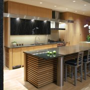 View of contemporary kitchen with wooden features and cabinetry, countertop, flooring, interior design, kitchen, room, brown, black