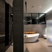 This home was designed by Gerrad Hall, the architecture, bathroom, floor, interior design, product design, room, sink, black