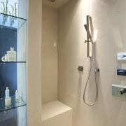 View of contemporary shower with cream walls. - bathroom, home, interior design, plumbing fixture, product design, room, orange