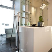 View of contemporary bathroom with dark flooring. - home, interior design, product design, gray