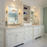 View of bathroom with white cabinetry and shelving. bathroom, bathroom cabinet, cabinetry, countertop, cuisine classique, floor, flooring, home, interior design, kitchen, room, sink, wall, gray