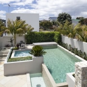 View of small pool up against fence. - backyard, estate, home, house, outdoor furniture, property, real estate, residential area, sunlounger, swimming pool, white