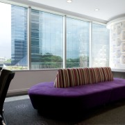 View of seating area with purple couches and ceiling, interior design, lobby, real estate, white, black