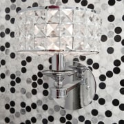Close up of lamp with spotted wallcovering. - design, metal, pattern, product, gray