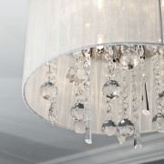 Close up of ceiling lamp. - Close up ceiling, ceiling fixture, chandelier, crystal, lampshade, light fixture, lighting, lighting accessory, product design, white, gray