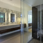 View of bathroom with tile wall feature and glass, interior design, room, window, gray, black
