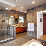View of bathroom with grey floor and wall bathroom, estate, home, interior design, real estate, room, gray, brown