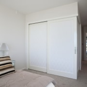 Bedroom with grey carpeting and white doors leading bed frame, bedroom, ceiling, daylighting, door, floor, home, house, interior design, property, real estate, room, wall, window, wood, gray, white