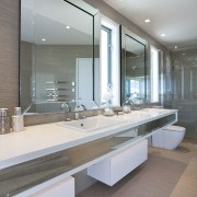 Bathroom with biege floors and walls and white architecture, bathroom, countertop, floor, interior design, real estate, room, sink, gray