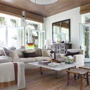 Lounge with cream sofas and floor matt. - home, interior design, living room, real estate, room, window, white