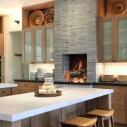 Kitchen with fireplace and island with white benchtops countertop, fireplace, flooring, hearth, interior design, kitchen, white, brown