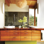 View of bathroom with wooden vanity and dark cabinetry, ceiling, chest of drawers, countertop, cuisine classique, floor, furniture, hardwood, home, interior design, kitchen, orange, room, table, wall, red