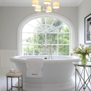 Light toned bathroom with large white tub and bathroom, estate, floor, furniture, home, house, interior design, plumbing fixture, room, sink, table, wall, window, gray