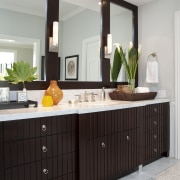 View of brown cabinetry with three rectangular mirrors. bathroom, bathroom accessory, bathroom cabinet, cabinetry, countertop, home, interior design, kitchen, room, sink, gray, black