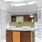 Walnut cabinetry lines the entry to this glass bathroom accessory, cabinetry, countertop, furniture, interior design, kitchen, product design, sink, white