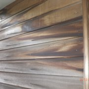 Close up of corner of house. - Close beam, floor, hardwood, lumber, plywood, wall, wood, wood stain, gray, brown