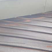 Close up of detail. - Close up of floor, line, plywood, roof, wood, wood stain, gray