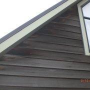 Close up of timber house. - Close up daylighting, facade, handrail, roof, siding, window, wood, wood stain, black, white