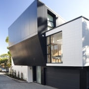 View of exterior with dark sloping wall. - architecture, building, facade, house, residential area, white