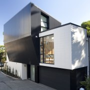 View of exterior with sloping wall. - View architecture, building, facade, home, house, property, real estate, residential area, white