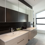 View of bathroom with cream twin vanities, row architecture, bathroom, cabinetry, countertop, interior design, kitchen, room, sink, gray