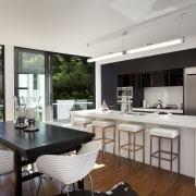 View of kitchen with white island and stools, architecture, countertop, house, interior design, kitchen, real estate, window, gray