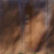 Exterior of house with rusted corten steel. Sustainable window, brown