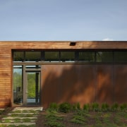 Exterior of house with rusted corten steel. Sustainable architecture, elevation, estate, facade, home, house, landscape, property, real estate, residential area, sky, window, wood, brown, teal