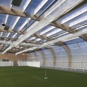 View of indoor sports area with curved roof. architecture, arena, daylighting, daytime, roof, sport venue, stadium, structure, gray, brown