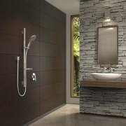Bathroom with brown wall and stone wall feature. bathroom, floor, flooring, home, interior design, room, tile, wall, black, gray