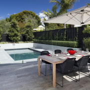Here is a home designed by Belinda George backyard, estate, leisure, outdoor furniture, outdoor structure, patio, property, real estate, sunlounger, swimming pool, table, gray