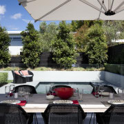 Here is a home designed by Belinda George backyard, estate, home, house, luxury vehicle, outdoor structure, patio, plant, property, real estate, roof, table, gray