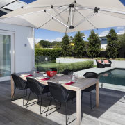 Here is a home designed by Belinda George outdoor structure, patio, real estate, roof, table, gray