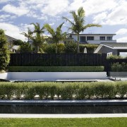 Here is a home designed by Belinda George architecture, backyard, estate, garden, grass, home, house, landscape, landscaping, lawn, luxury vehicle, plant, property, real estate, reflecting pool, residential area, swimming pool, villa, water, white
