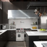 stainless stell oven, cooktop and rangehood,, stone floors, cabinetry, countertop, cuisine classique, home appliance, interior design, kitchen, kitchen stove, black