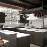 two islands, pot rack, stone floors, white benchtops countertop, interior design, kitchen, black
