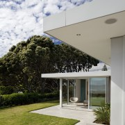 lawn and paving outside house. - lawn and architecture, estate, facade, home, house, real estate, residential area, sky, gray, white
