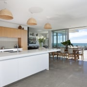 kitchen dining area and patio, white island, wood interior design, kitchen, property, real estate, gray