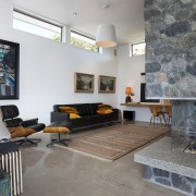entertainment space, stone schist, leather furniture, high ceilings, architecture, ceiling, floor, flooring, house, interior design, living room, loft, real estate, room, table, wall, gray