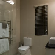 Bathroom with white toilet and towel rail. - bathroom, interior design, property, room, brown