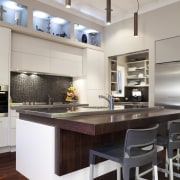 white cabinets at rear, island is dominant in cabinetry, ceiling, countertop, cuisine classique, interior design, kitchen, room, table, gray