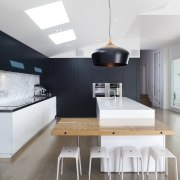 The addition accommodating the kitchen, dining and living architecture, countertop, dining room, house, interior design, kitchen, room, table, white, black