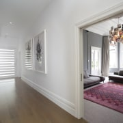 The original wide hallway remains a key feature ceiling, door, estate, floor, flooring, hardwood, home, house, interior design, laminate flooring, property, real estate, room, window, wood, wood flooring, gray