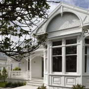 All the original character of this return-veranda bungalow architecture, building, cottage, estate, facade, historic house, home, house, mansion, outdoor structure, porch, property, real estate, residential area, siding, structure, tree, window, white