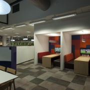Patterned grey flooring and orange and purple patterened ceiling, interior design, lobby, office, black, gray