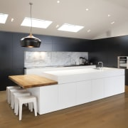 The large white island with built-in wooden breakfast countertop, floor, flooring, furniture, interior design, kitchen, product design, room, wood flooring, gray
