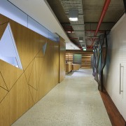 Hallway with triange cutout design on walls. - architecture, ceiling, daylighting, floor, wood, brown, gray