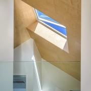 A skylight in the living area's birch veneer