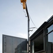 Close up of exterior being constructed. - Close sky, street light, white